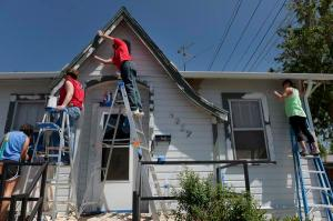 WELLS FARGO AND BROTHERS REDEVELOPMENT HELP TWO ELDERLY SISTERS PAINT AND REPAIR THE HOME THEY HAVE LIVED IN FOR 54 YEARS.